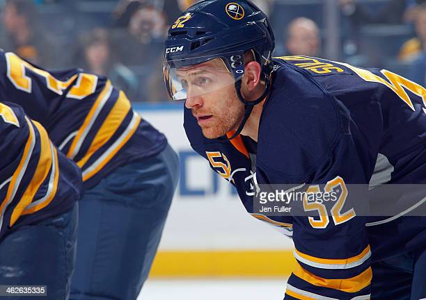 Alexander Sulzer of the Buffalo Sabres prepares for a faceoff against the Boston Bruins at First Niagara Center on December 19 2013 in Buffalo New...