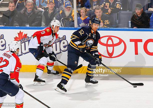 Alexander Sulzer of the Buffalo Sabres skates against Stephen Weiss of the Florida Panthers at First Niagara Center on February 3 2013 in Buffalo New...