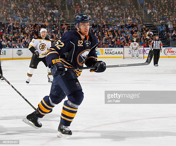 Alexander Sulzer of the Buffalo Sabres skates against the Boston Bruins at First Niagara Center on December 19 2013 in Buffalo New York