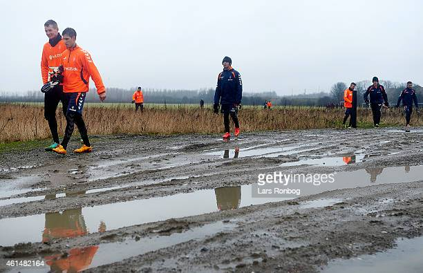 Alexander Szymanowski and Goalkeeper Lukas Hradecky of Brondby IF leads the Brondby IF squad walking away after the Brondby IF first training session...