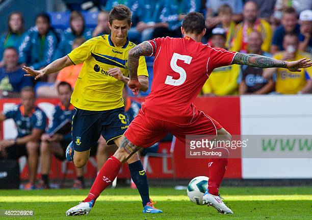 Alexander Szymanowski of Brondby IF and Daniel Agger of Liverpool FC compete for the ball during the PreSeason Friendly match between Brondby IF and...