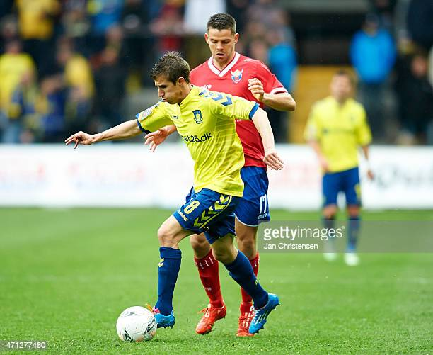 Alexander Szymanowski of Brondby IF and Marc Dal Hende of FC Vestsjalland compete for the ball during the Danish Alka Superliga match between Brondby...