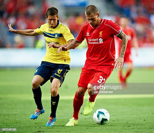 Alexander Szymanowski of Brondby IF and Martin Skrtel of Liverpool FC compete for the ball during the PreSeason Friendly match between Brondby IF and...