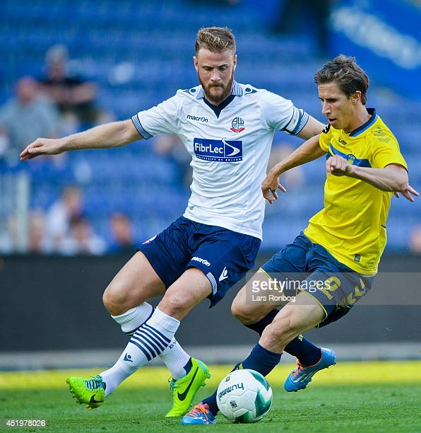 Alexander Szymanowski of Brondby IF and Matt Mills of Bolton Wanderers compete for the ball during the PreSeason Friendly match between Brondby IF...