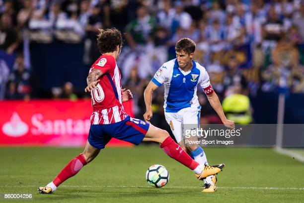 Alexander Szymanowski of CD Leganes fights for the ball with Sime Vrsaljko of Atletico de Madrid during the La Liga 201718 match between CD Leganes...