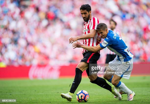Alexander Szymanowski of Club Deportivo Leganes competes for the ball with Raul Garcia of Athletic Club during the La Liga match between Athletic...