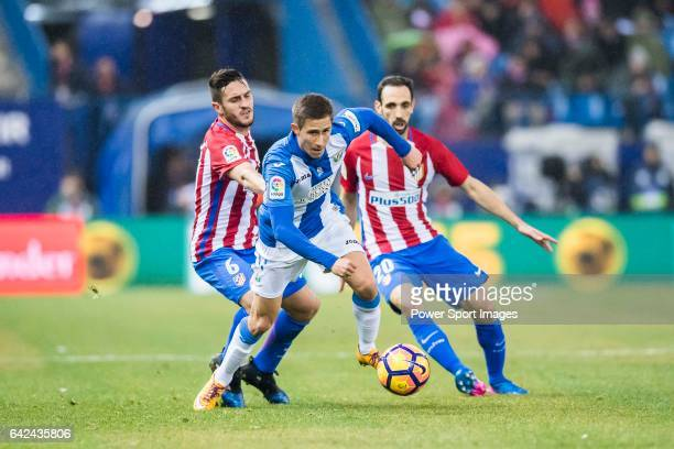 Alexander Szymanowski of Deportivo Leganes battles for the ball with Jorge Resurreccion Merodio Koke and Juan Francisco Torres Belen Juanfran of...