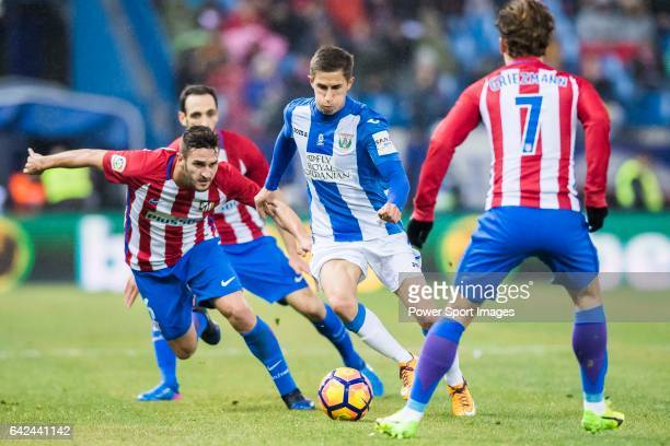 Alexander Szymanowski of Deportivo Leganes battles for the ball with Jorge Resurreccion Merodio Koke of Atletico de Madrid during their La Liga match...