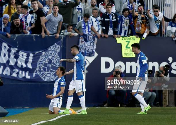 Alexander Szymanowski of Leganes celebrates with his teammates after scoring during the La Liga football match between Leganes and Deportivo La...