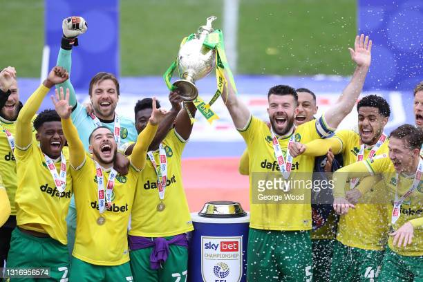 Alexander Tettey and Grant Hanley of Norwich City lift the Sky Bet Championship trophy after the Sky Bet Championship match between Barnsley and...