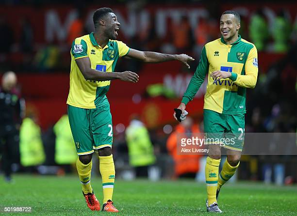 Alexander Tettey and Martin Olsson of Norwich City celebrate their team's 21 win in the Barclays Premier League match between Manchester United and...