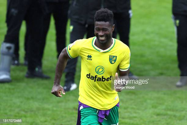 Alexander Tettey of Norwich City runs to collect the Sky Bet Championship trophy following the Sky Bet Championship match between Barnsley and...