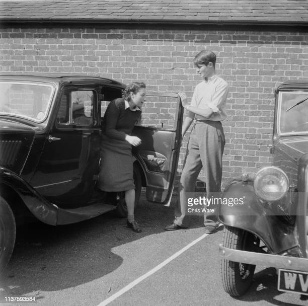 Alexander Thynn Viscount Weymouth holds a door for a visitor to his family seat Longleat House near Warminster Wiltshire 22nd April 1949 Thynn's...