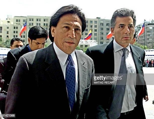 Alexander Toledo former Peruvian opposition candidate enters La Monde Presidential Palace in Santiago Chile accompanied by Peruvian journalist Alvaro...