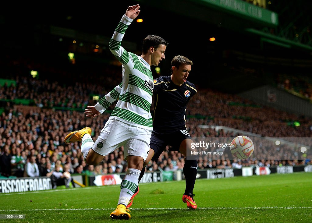 Alexander Tonev of Celtic and Josip Pivaric of Dinamo Zagreb challenge during the UEFA Europa League group D match between Celtic and Dinamo Zagreb at Celtic Park on October 02, 2014 in Glasgow, Scotland.