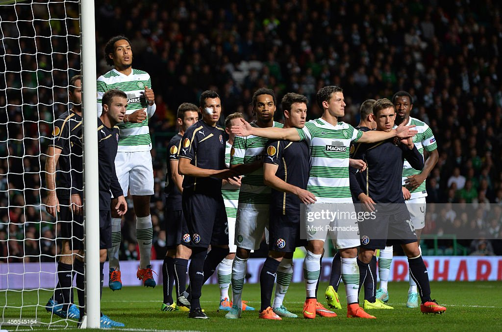 Alexander Tonev of Celtic is tightly marked in the penalty box during the 1-0 victory over Dinamo Zagreb during the UEFA Europa League group D match between Celtic and Dinamo Zagreb at Celtic Park on October 02, 2014 in Glasgow Scotland.