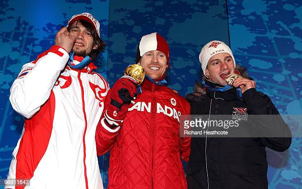 Alexander Tretyakov of Russia receives the bronze medal Jon Montgomery of Canada receives the gold medal and Martins Dukurs of Latvia receives the...