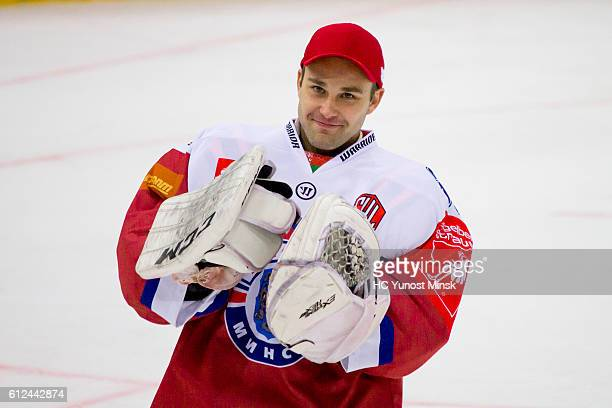 Alexander Tryanichev of Yunost Minsk celebrates his teams win after the 3rd period of Champions Hockey League Round of 32 match between Yunost Minsk...