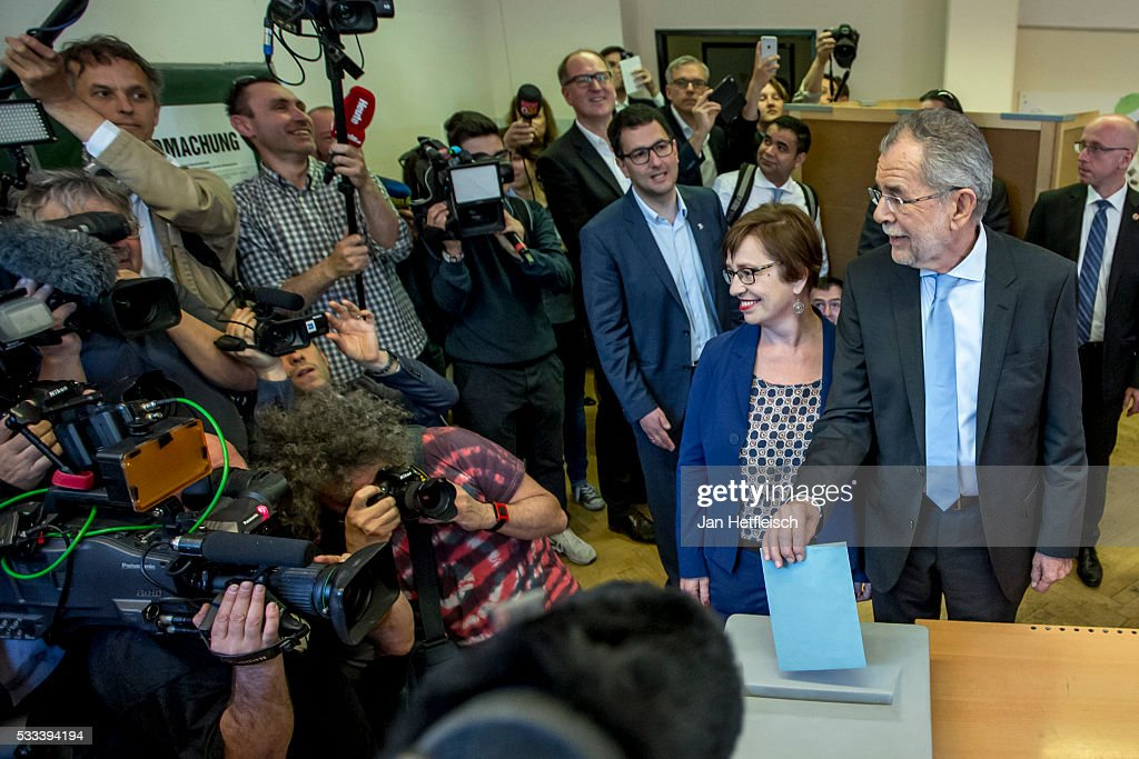 Alexander Van der Bellen, presidential candidate of the Green Party, casts his ballot at a polling station during the Austrian presidential election on May 22, 2016 in Vienna, Austria.