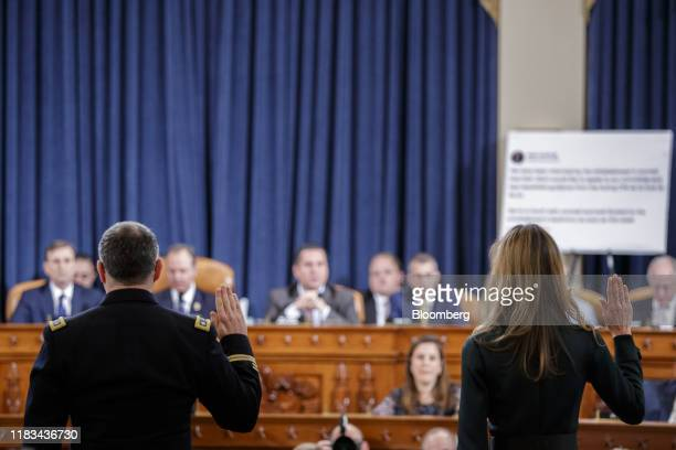 Alexander Vindman director for European affairs on the National Security Council left and Jennifer Williams aide to Vice President Mike Pence swearin...