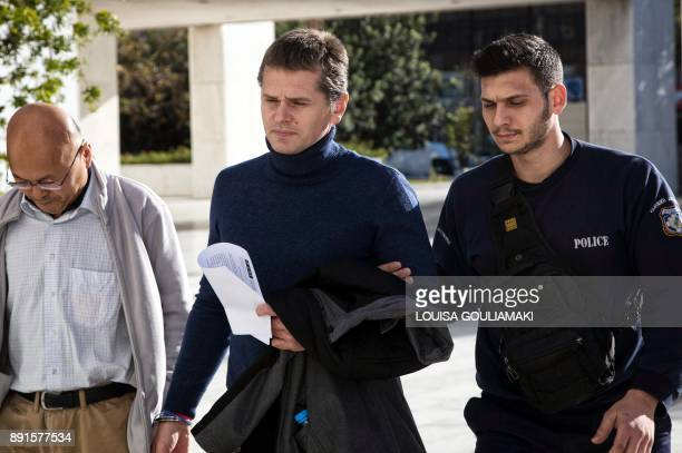 Alexander Vinnik who headed BTCe an exchange he operated for the cyber currency is escorted by police after Greece's Supreme Court has ruled on...