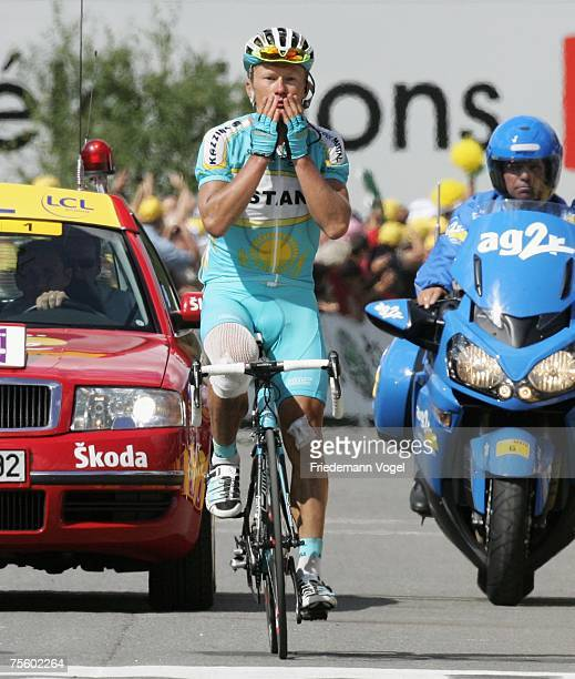 Alexander Vinokourov of Kazakhstan and Team Astana celebrates as he crosses the line to win the stage fifteen of the Tour de France from Foix to...