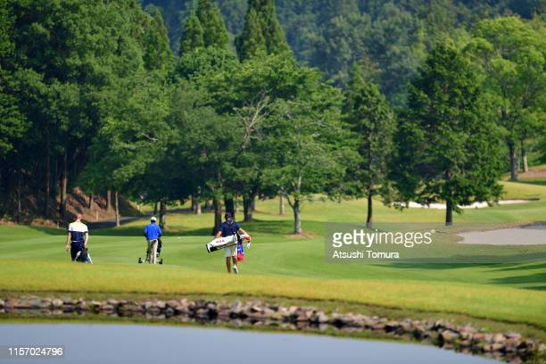 Alexander Vogelsong of the United States, Pongsapak Laopakdee of Thailand and Rasmus Hjelm of Sweden walk on the 1st hole during the third round of...