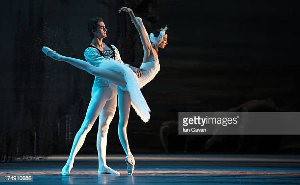 Alexander Volchkov and Svetlana Zakharova of the Bolshoi Ballet perform during a photocall for 'Swan Lake' at The Royal Opera House on July 29 2013...