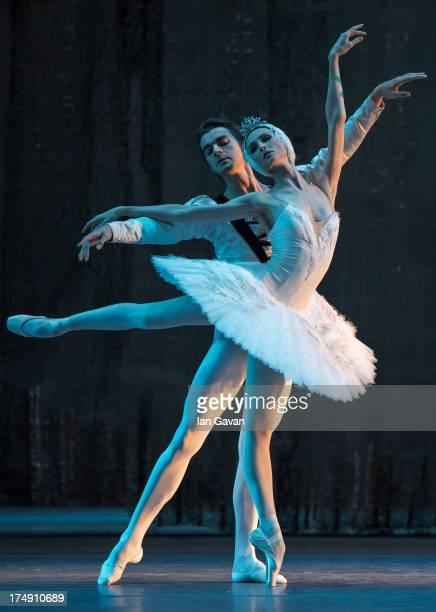 Alexander Volchkov and Svetlana Zakharova of the Bolshoi Ballet perform during a photocall for 'Swan Lake' at The Royal Opera House on July 29 2013...