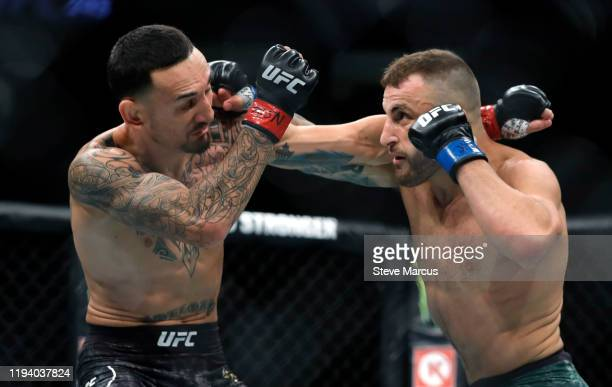 Alexander Volkanovski battles with UFC featherweight champion Max Holloway in their title fight during UFC 245 at T-Mobile Arena on December 14, 2019...
