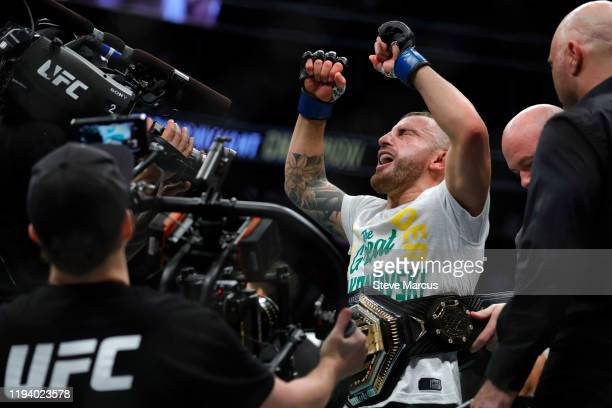 Alexander Volkanovski celebrates after defeating UFC featherweight champion Max Holloway in their title fight during UFC 245 at TMobile Arena on...