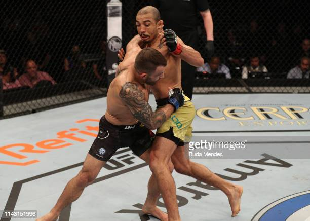 Alexander Volkanovski of Australia attempts to take down Jose Aldo of Brazil in their featherweight bout during the UFC 237 event at Jeunesse Arena...