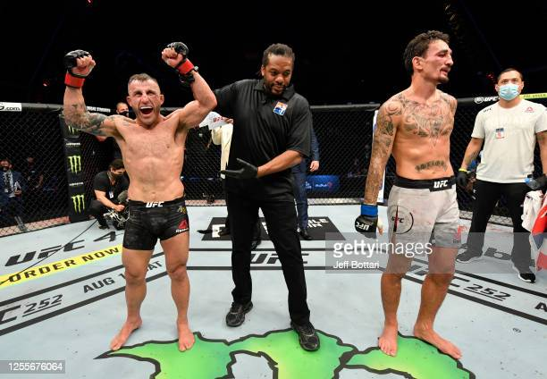 Alexander Volkanovski of Australia celebrates after his splitdecision victory over Max Holloway in their UFC featherweight championship fight during...