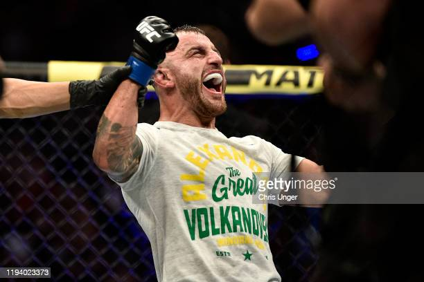 Alexander Volkanovski of Australia celebrates his win in the octagon during the UFC 245 event at T-Mobile Arena on December 14, 2019 in Las Vegas,...