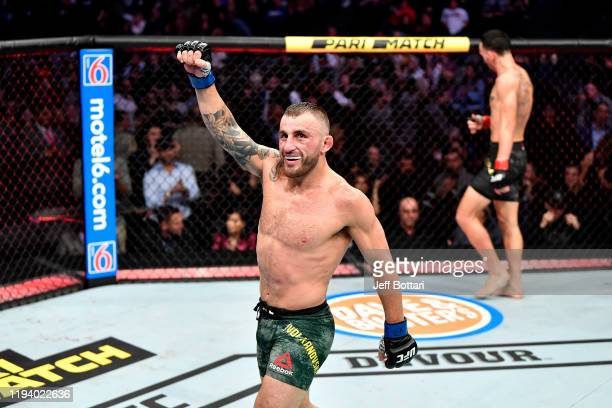 Alexander Volkanovski of Australia celebrates in the octagon at the end of the match during the UFC 245 event at T-Mobile Arena on December 14, 2019...