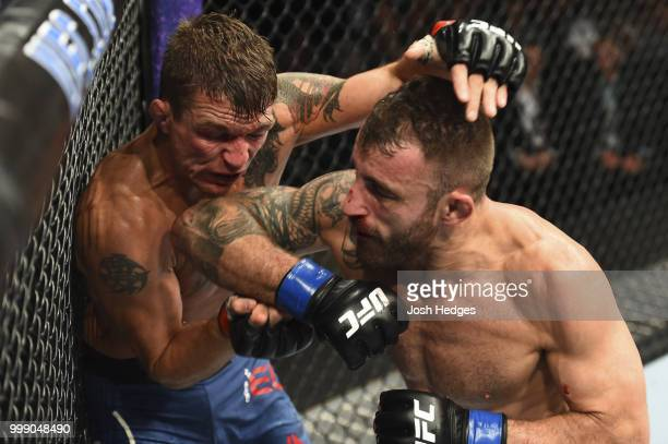 Alexander Volkanovski of Australia elbows Darren Elkins in their featherweight fight during the UFC Fight Night event inside CenturyLink Arena on...