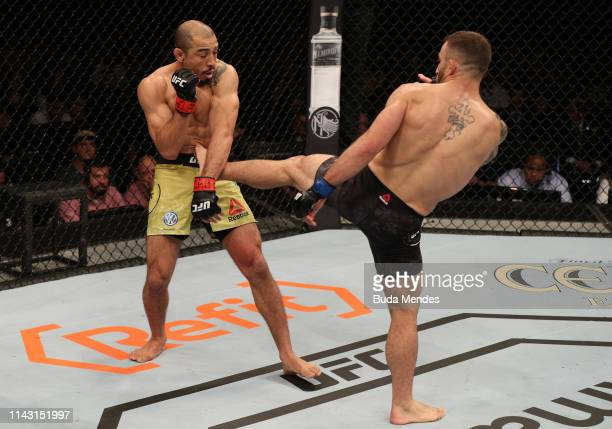 Alexander Volkanovski of Australia kicks Jose Aldo of Brazil in their featherweight bout during the UFC 237 event at Jeunesse Arena on May 11 2019 in...