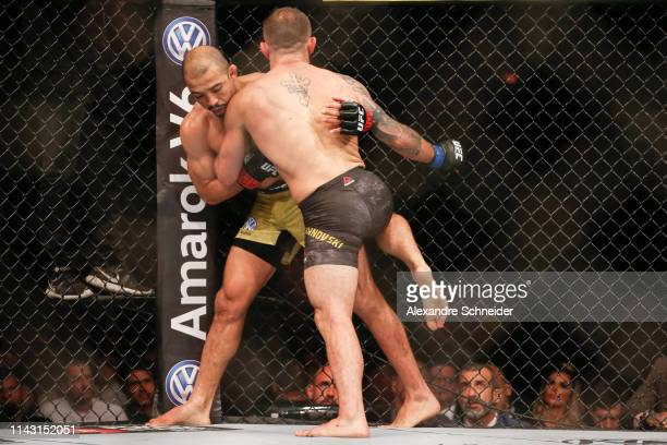 Alexander Volkanovski of Australia knees Jose Aldo of Brazil in their Featherweight bout during the UFC 237event at Jeunesse Arena on May 11 2019 in...