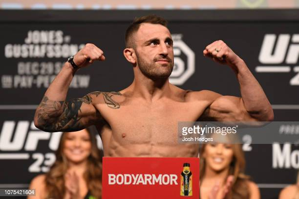 Alexander Volkanovski of Australia poses on the scale during the UFC 232 weighin inside The Forum on December 28 2018 in Inglewood California