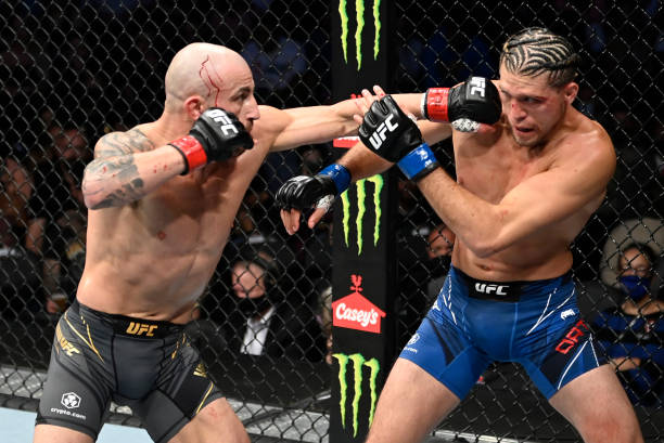Alexander Volkanovski of Australia punches Brian Ortega in their UFC featherweight championship fight during the UFC 266 event on September 25, 2021...
