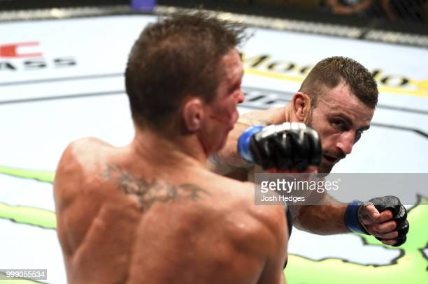 Alexander Volkanovski of Australia punches Darren Elkins in their featherweight fight during the UFC Fight Night event inside CenturyLink Arena on...