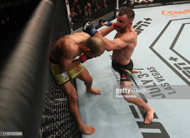 Alexander Volkanovski of Australia punches Jose Aldo of Brazil in their featherweight bout during the UFC 237 event at Jeunesse Arena on May 11 2019...