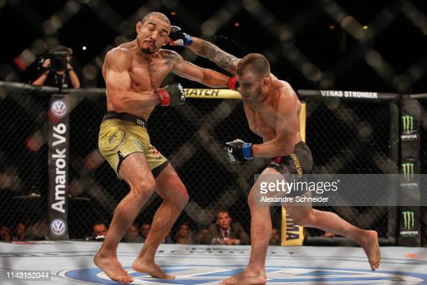 Alexander Volkanovski of Australia punches Jose Aldo of Brazil in their Featherweight bout during the UFC 237event at Jeunesse Arena on May 11 2019...