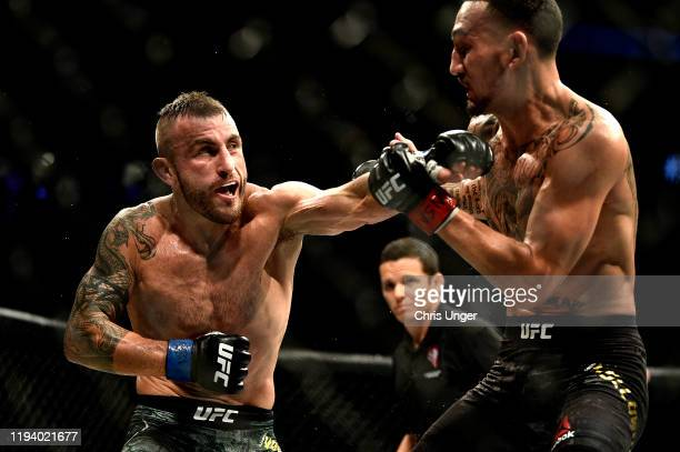 Alexander Volkanovski of Australia punches Max Holloway in their UFC featherweight championship bout during the UFC 245 event at T-Mobile Arena on...