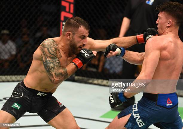 Alexander Volkanovski of Australia punches Shane Young of New Zealand in their catchweight bout during the UFC Fight Night event inside the Qudos...