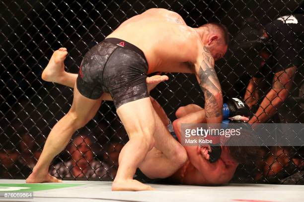 Alexander Volkanovski of Australia punches Shane Young of New Zealand in their catchweight bout during the UFC Fight Night at Qudos Bank Arena on...