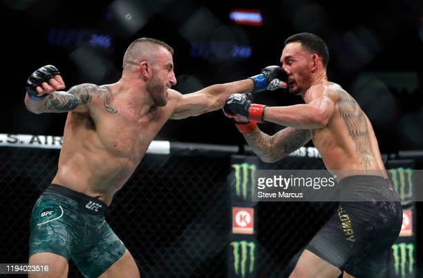 Alexander Volkanovski punches UFC featherweight champion Max Holloway in their title fight during UFC 245 at TMobile Arena on December 14 2019 in Las...