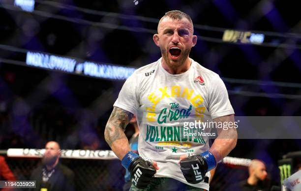Alexander Volkanovski yells after five rounds against UFC featherweight champion Max Holloway in their title fight during UFC 245 at TMobile Arena on...