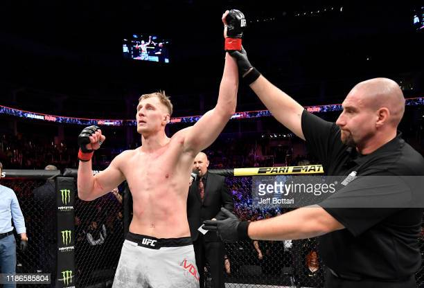 Alexander Volkov of Russia celebrates after his victory over Greg Hardy in their heavyweight bout during the UFC Fight Night event at CSKA Arena on...