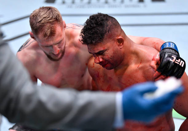 Alexander Volkov of Russia consoles Alistair Overeem of the Netherlands after his knockout victory in their heavyweight fight during the UFC Fight...